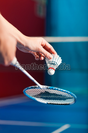 badminton in a gym hand