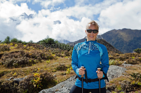woman exercising in mountains