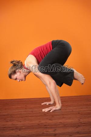 woman in bakasana posture