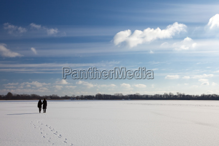 couple walking on the ice of