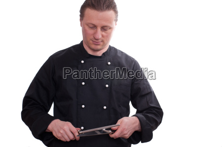 chef sharpening a knife with a