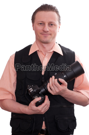smiling man with a camera and