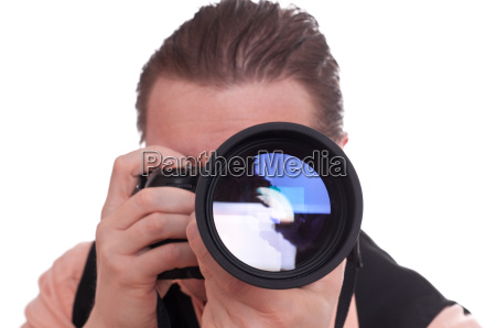 photographer with camera and telephoto lens