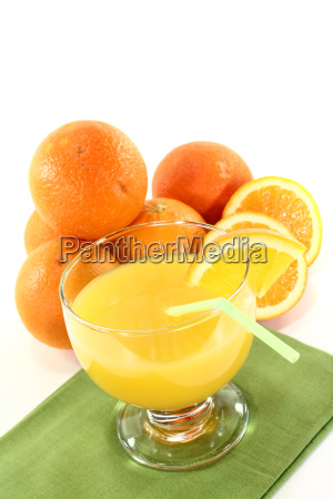 fresh orange juice with orange halves
