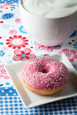 pink donut and a cup of