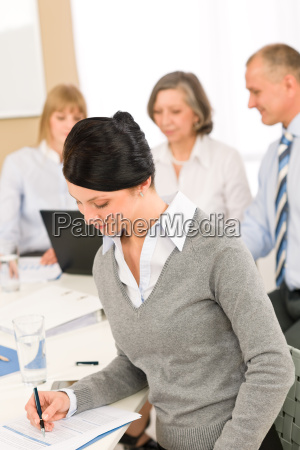 young executive woman take notes during
