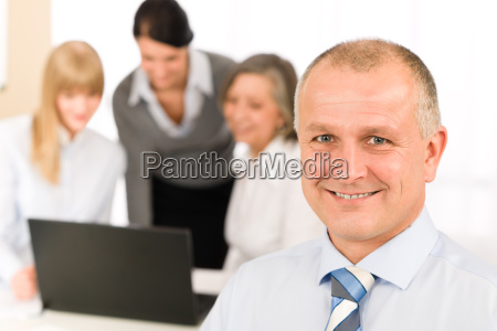 smiling businessman during team meeting