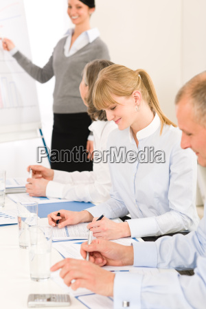 giving presentation young woman during meeting