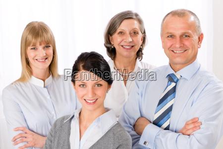 confident business team smiling portrait