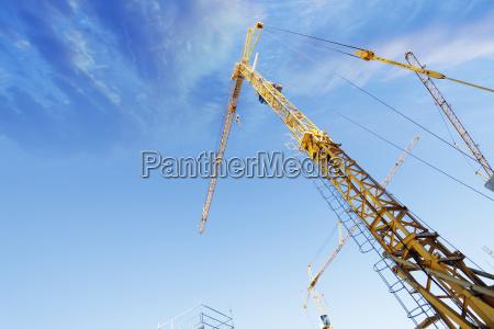 construction cranes and blue sky