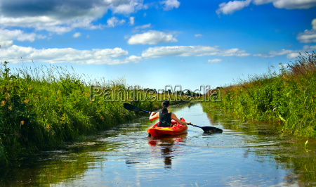 woman in canoe on a river