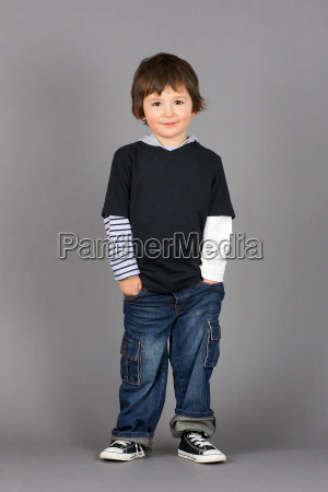 boy with hands in pockets