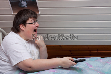 mentally disabled woman with remote control