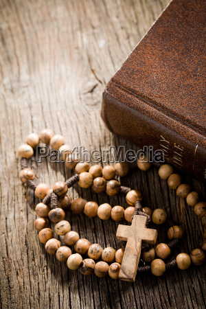 wooden rosary and the bible