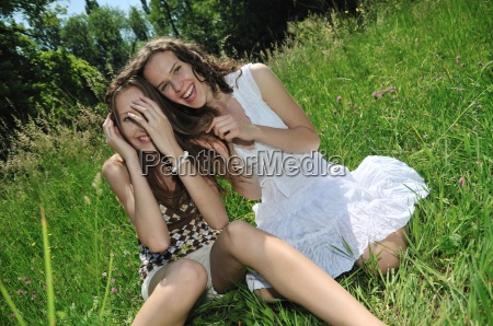 happy friends together outside in nature