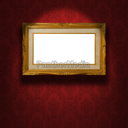 empty golden frame on the wall