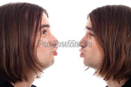 profile of man making kiss face