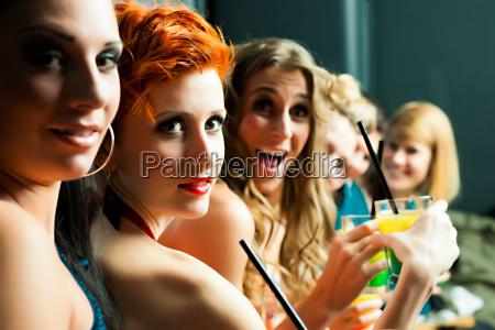 women in a club or a