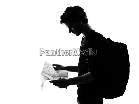 young man backpacker silhouette