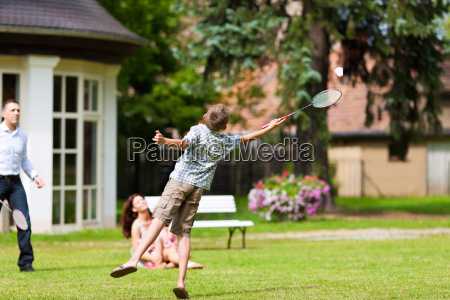 family playing in summer in front