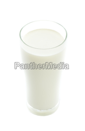 milk in the glass on white
