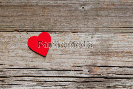 a heart on wood background