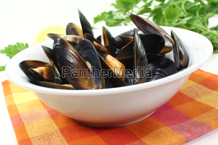 mussels in a white dish