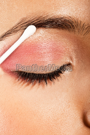 applying eye makeup eye closed