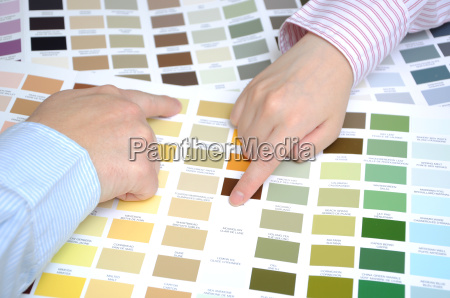 business people with swatches to decide