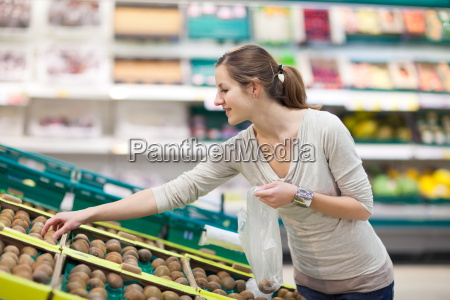 pretty young woman shopping in a
