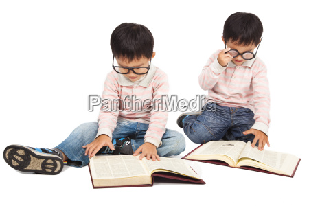 children reading book on the