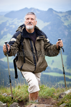 handsome senior hiking in the mountains