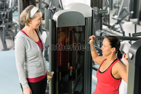 personal trainer at fitness center showing