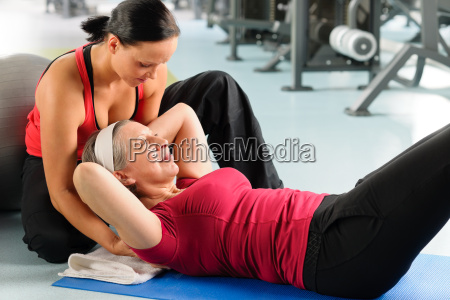 senior woman exercise abdominal in fitness