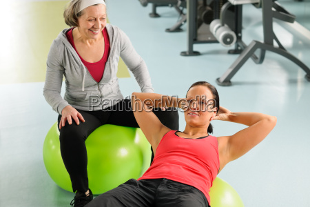 senior woman with trainer exercising fitness