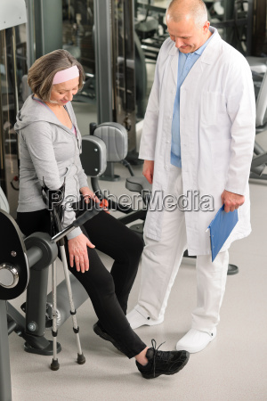 senior woman with help of physiotherapist