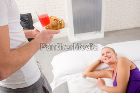 woman lying on the bed man
