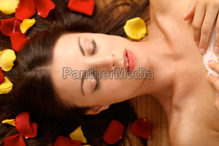 woman lying on ground surrounded by