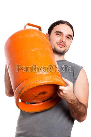 man holding gas bottle