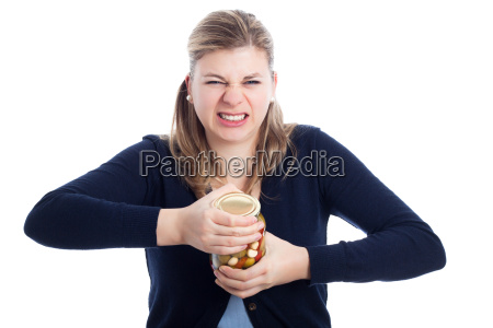 woman struggling to open bottle