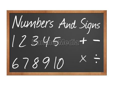 numbers and signs on blackboard