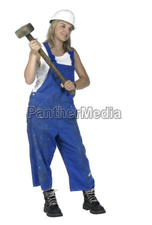 girl dressed in workwear holding a