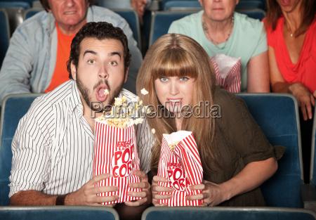 couple spills their popcorn