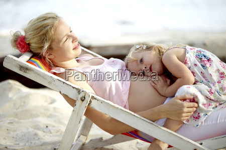 young pregnant mother sitting with her