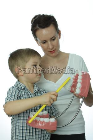 young 5 brushing