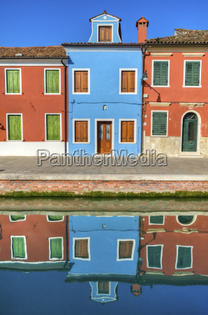 colorful burano italy canal reflections