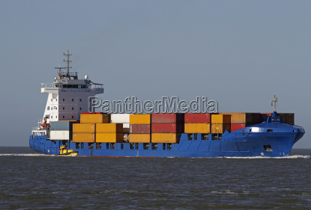 container ship with pilot boat