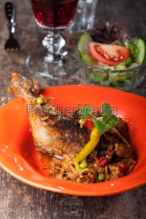 grilled chicken leg on rice with