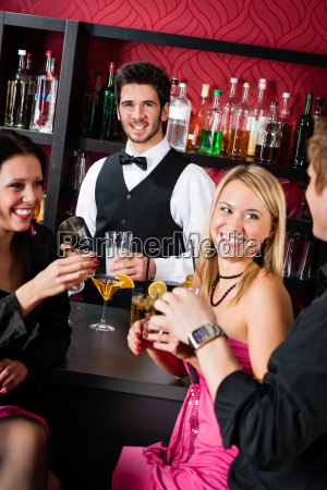 barman prepare cocktails friends drinking at