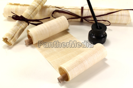 papyrus scrolls with quill